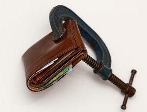 a wallet in between clamps
