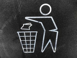 avoid unwanted moving expenses- a image of a man throwing the paper away