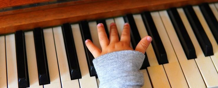 Child's hand on the piano