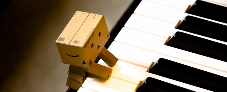 carboard doll playing piano