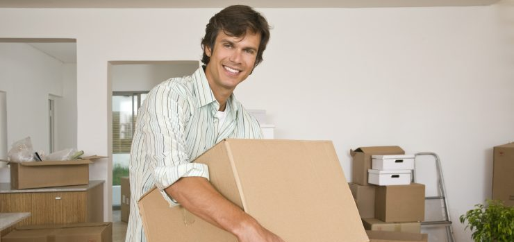 Man holding moving boxes