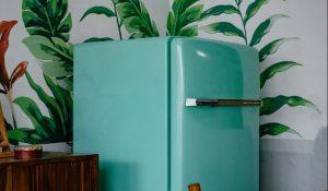 A green fridge in a kitchen