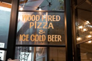 Wooden framed glass door of a local cafe/restaurant