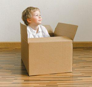Kid inside cardboard box