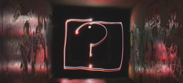 question mark written in neon light