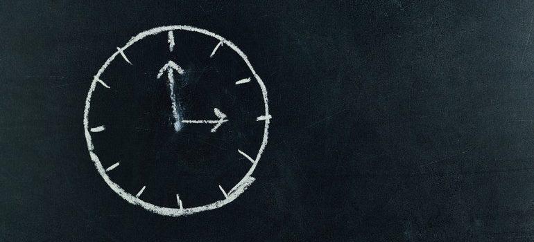 Analog clock drawn on a blackboard.