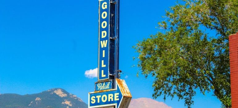 A Goodwill store sign - you can donate things to Goodwill when minimalist moving
