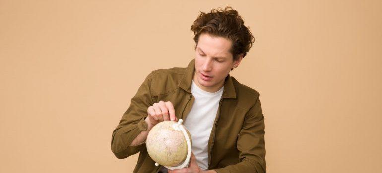 A man looking at the globe