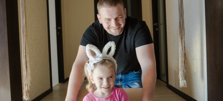 A father and daughter relocating