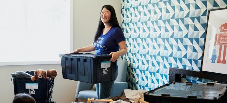 A woman unpacking after her move