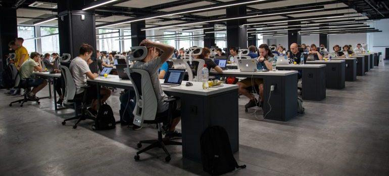 people sitting in a IT office