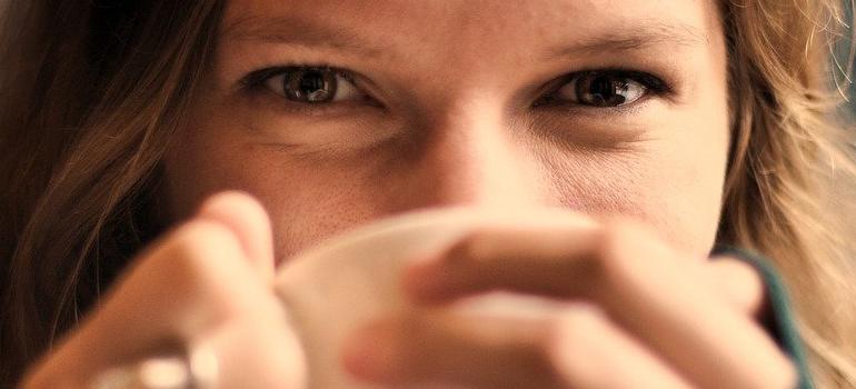 a woman enjoying coffee