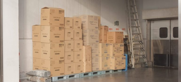 neatly stacked cardboard boxes