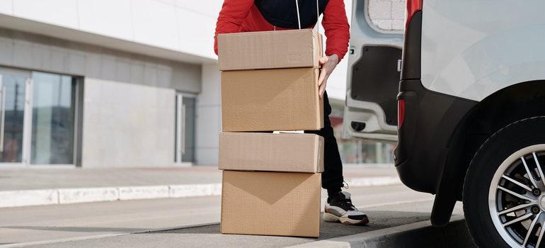 Guy loads boxes in truck