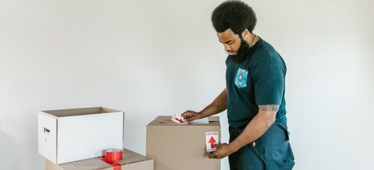 Picture of a moving professional. There are many things that can go wrong during a residential move if you hire amateur movers
