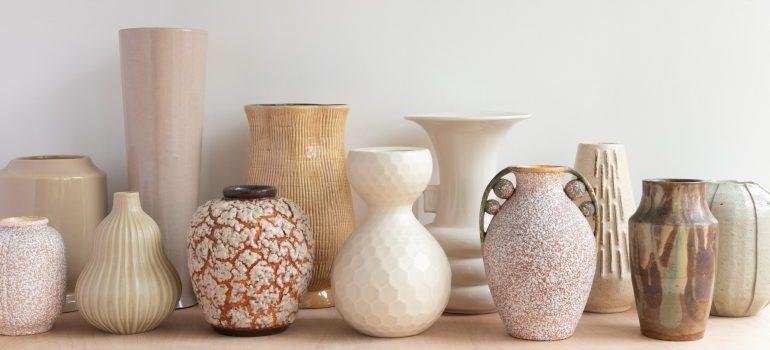 white and brown ceramic vases