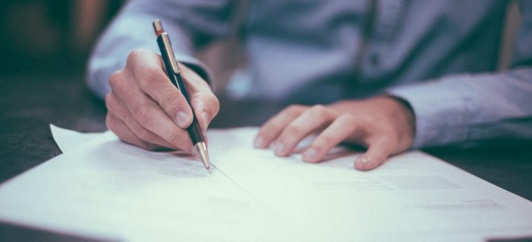 person signing an insurance contract