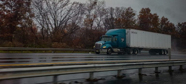 a moving truck on the road moving from California to Nevada